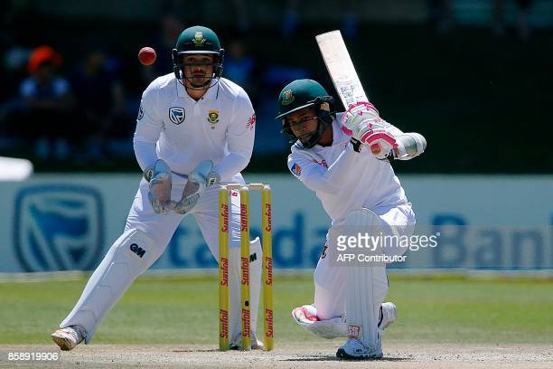 Bangladesh's batsman Mushfiqur Rahim is watched by South Africa's wicketkeeper Quinton de Kock as he plays a shot during the third day of the second...