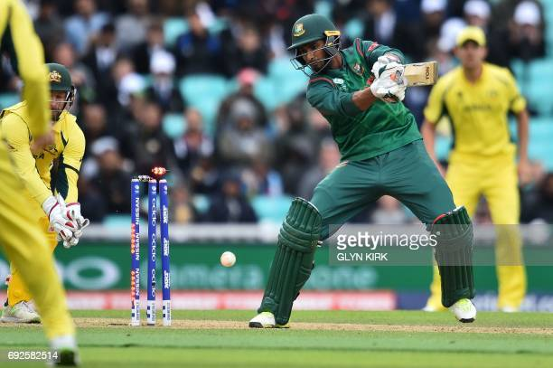 Bangladesh's Mahmudullah looks to the stumps as he loses his wicket for 8 runs during the ICC Champions Trophy match between Australia and Bangladesh...
