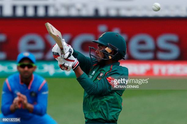 Bangladesh's Mehedi Hasan Miraz plays a shot to be caught by India's Dinesh Karthik off the bowling of India's Jasprit Bumrah for 24 runs during the...