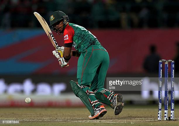 Bangladesh's Mohmad Shabir Rahaman plays a shot during the qualifying match for the World T20 cricket tournament between Bangladesh and Oman at The...