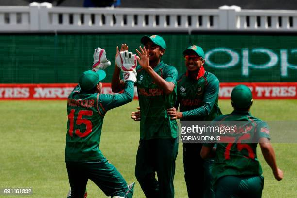 Bangladesh's Mushfiqur Rahim congratulates Bangladesh's Mustafizur Rahman after he took the catch to take the wicket of England's Jason Roy off the...