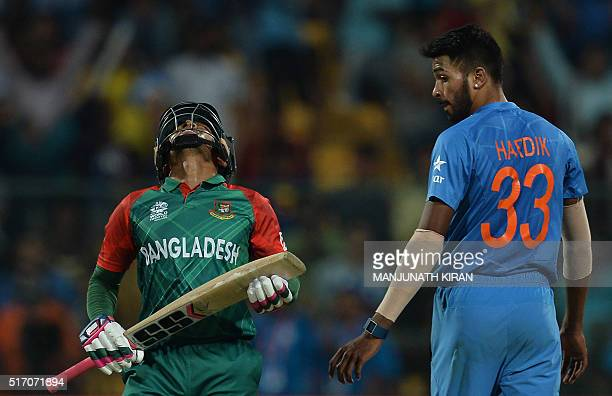 Bangladesh's Mushfiqur Rahim reacts after his dismissal as Indian bowler Hardik Pandaylooks on during the World T20 cricket tournament match between...
