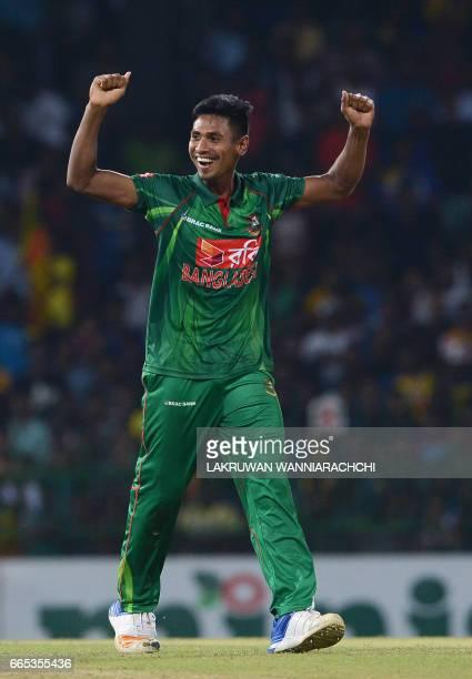 Bangladesh's Mustafizur Rahman celebrates after dismissing Sri Lanka's Chamara Kapugedera during the second T20 international cricket match between...