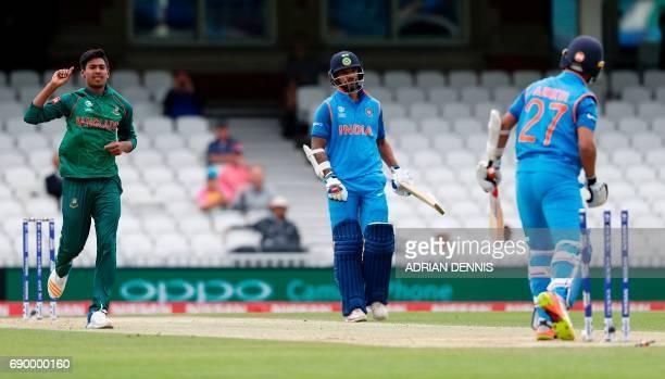 Bangladesh's Mustafizur Rahman celebrates taking the wicket of India's Ajinkya Rahane for 11 runs during the ICC Champions Trophy Warmup cricket...