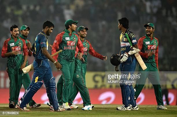Bangladesh's players celebrate after winning the Asia Cup T20 cricket tournament match against Sri Lanka at the ShereBangla National Cricket Stadium...