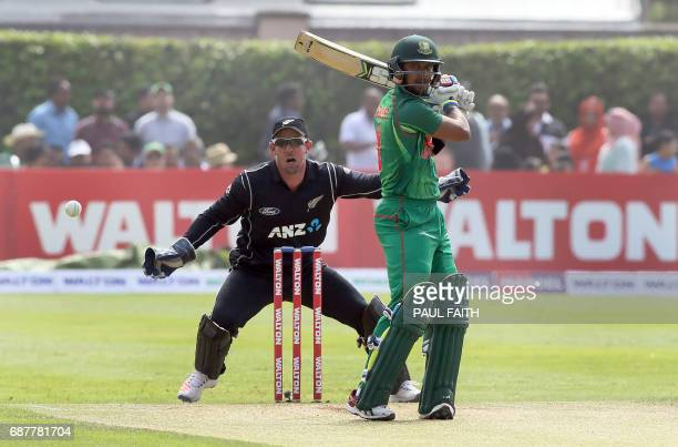 Bangladesh's Sabbir Rahman bats as New Zealand wicketkeeper Luke Ronchi looks on during the TriSeries final OneDay International between Bangladesh...