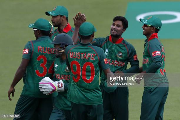 Bangladesh's Sabbir Rahman celebrates with teammates after taking the wicket of England's Alex Hales for 95 during the ICC Champions trophy cricket...