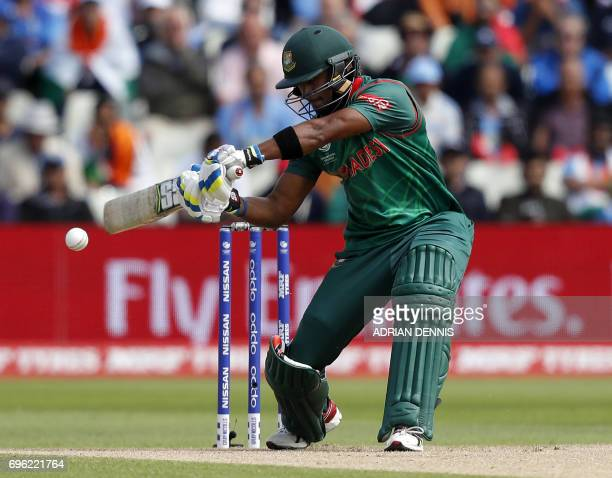 Bangladesh's Sabbir Rahman plays a shot which is caught by India's Ravindra Jadeja during the ICC Champions Trophy semifinal cricket match between...