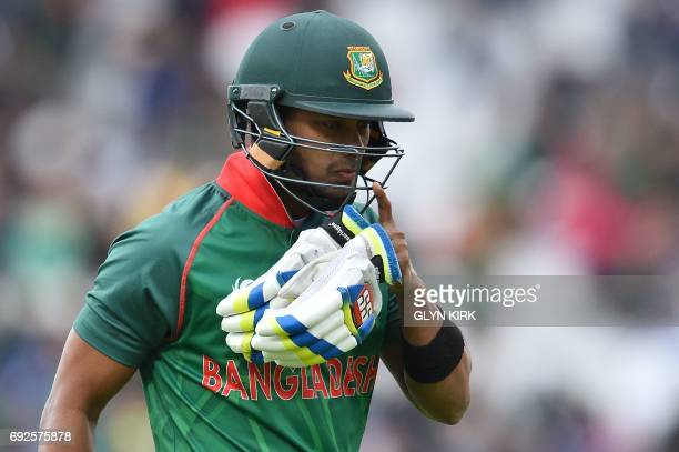 Bangladesh's Sabbir Rahman walks back to the pavilion after losing his wicket for 8 runs during the ICC Champions Trophy match between Australia and...