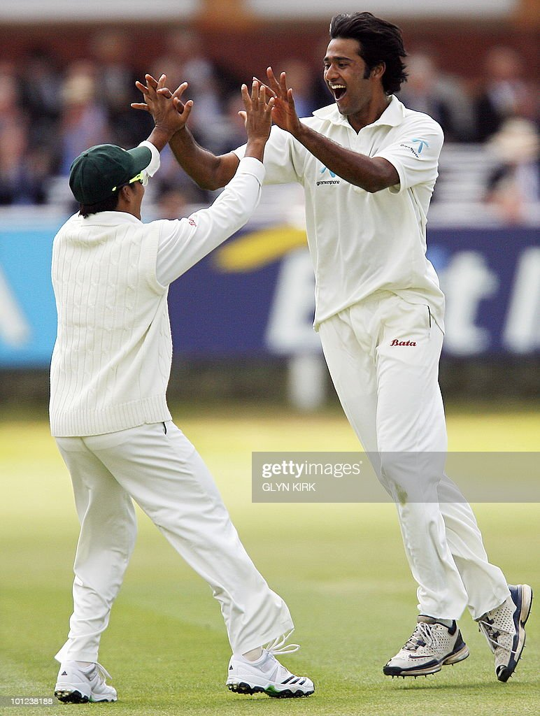Bangladesh's Shahadat Hossain (R) celebrates taking the wicket of England's James Anderson (not pictured) for 13 runs on the second day of the first Test match against England at Lord's Cricket Ground in London, on May 28, 2010.