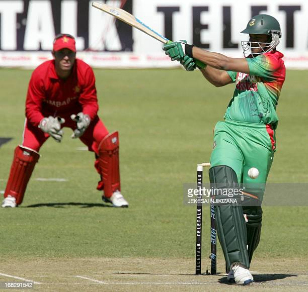 Bangladesh's Shakib Al Hasan ibats as Zimbabwe captain Brendan Taylor watches during the 3rd and final match of the three match ODI cricket series...