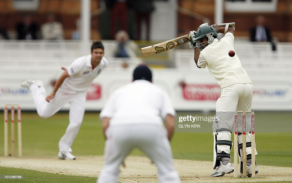 Bangladesh's Shakib Al Hasanon (R) looks behind just before being caught by England's Andrew Strauss (L) for 25 runs on the third day of the first Test match against England at Lord's Cricket Ground in London, England on May 29, 2010.