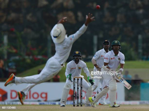 Bangladesh's Soumya Sarkar Sri Lanka's wicket keeper Niroshan Dickwella and Sri Lanka's Asela Gunerathne watche as Sri Lanka's Dinesh Chandimal drops...