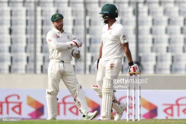 Bangladesh's Tamim Iqbal And Australia's Matthew Wade are talking to eact other during day two of the First Test match between Bangladesh and...