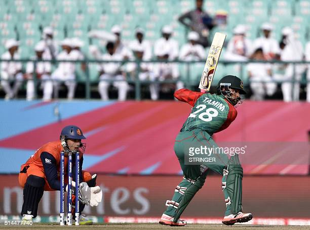 Bangladesh's Tamim Iqbal is watched by Netherlands's wicketkeeper Wesley Barresi during the World T20 cricket tournament match between Bangladesh and...