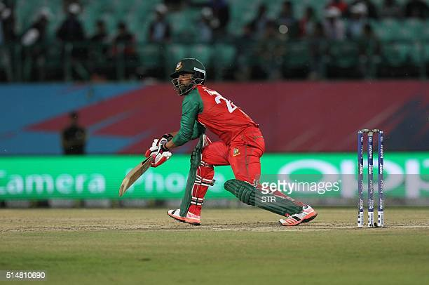 Bangladesh's Tamim Iqbal Khan hits a boundary during their T20 World Cup Cricket tournament match against Ireland at the HPCA stadium in Dharamsala...