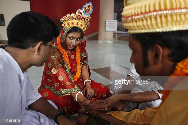 BangladeshwomenreligionHindurightsFEATURE by Shafiq Alam This picture taken on June 19 shows a Bangladeshi couple performing wedding rituals...