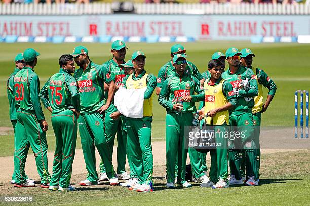 Banglash players watch a reply of Tom Latham of New Zealand's wicket during the second One Day International match between New Zealand and New...