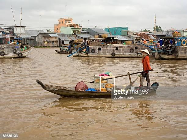 Banh mi vendor in boat, Vietnam