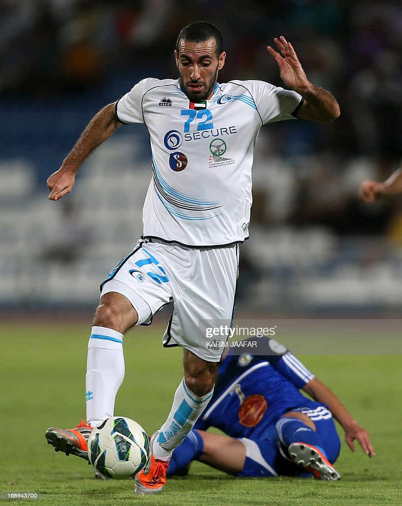 Baniyas' Egyptian striker Mohamed Aboutrika (front) advances with the ball past Al-Khor's Saud Sabah during their GCC Champions League first leg final football match at Al-Khor Stadium in Doha on May 17, 2013.