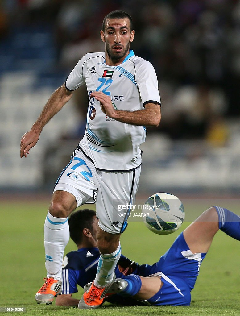 Baniyas' Egyptian striker Mohamed Aboutrika (front) advances with the ball past Al-Khor's Saud Sabah during their GCC Champions League first leg final football match at Al-Khor Stadium in Doha on May 17, 2013. AFP PHOTO / AL-WATAN DOHA / KARIM JAAFAR == QATAR OUT ==