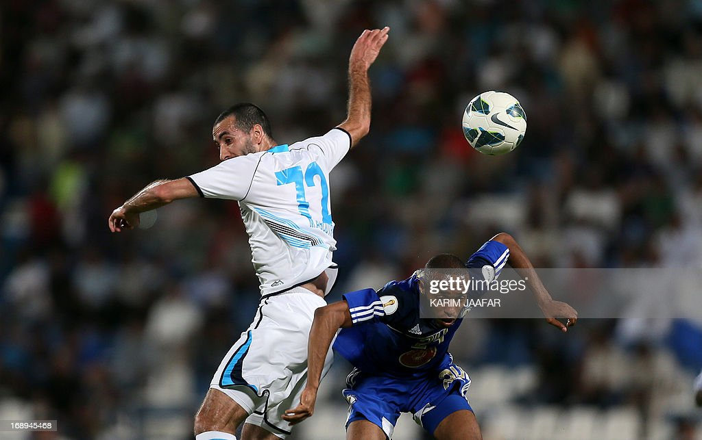 Baniyas' Egyptian striker Mohamed Aboutrika (L) challenges Al-Khor's Mohammed Jumaa during their GCC Champions League first leg final football match at Al-Khor Stadium in Doha on May 17, 2013.