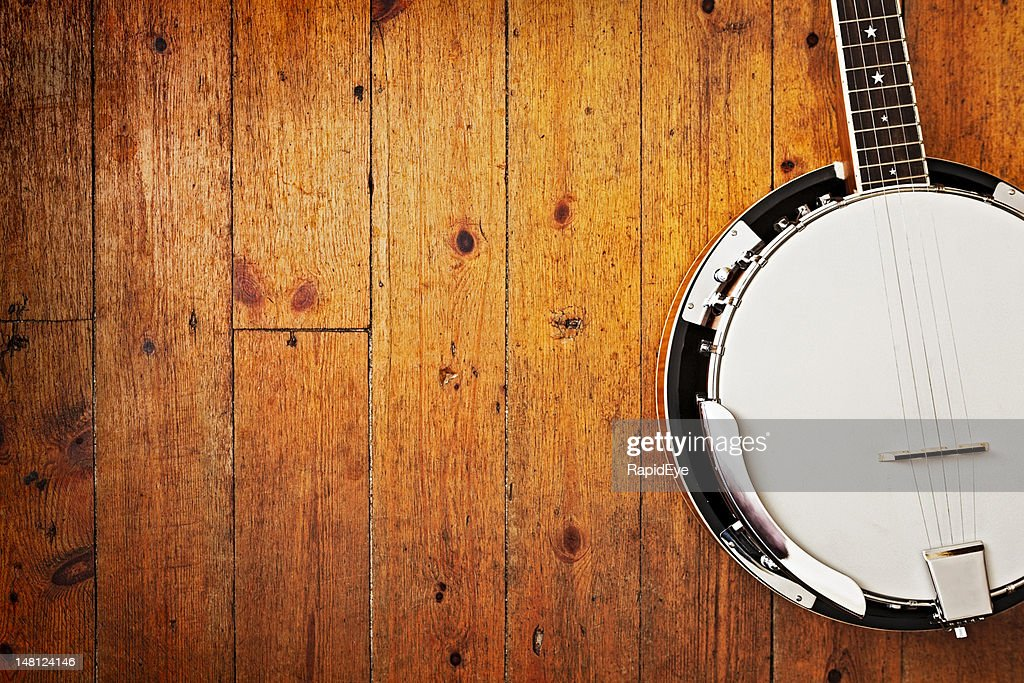 Banjo on wood background