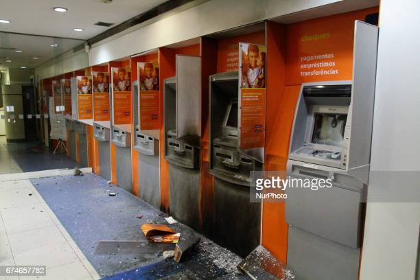 A bank ATM damaged by protestors during a nationwide general strike on April 28 2017 in Sao Paulo Brazil The general strike was conducted in cities...