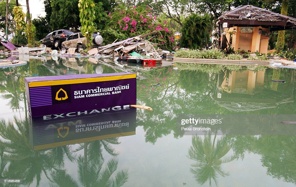 A bank automated teller machine rests submerged in the pool of the Holiday Inn hotel near wrecked cars December 27 2004 along Patong Beach one of the...