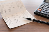 home finance concept. pen ,bank book account and calculator on desk.