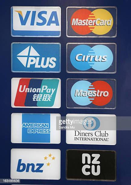 Bank card signage is seen after a press conference announcing the class suit to reclaim bank fees on March 11 2013 in Auckland New Zealand Three...