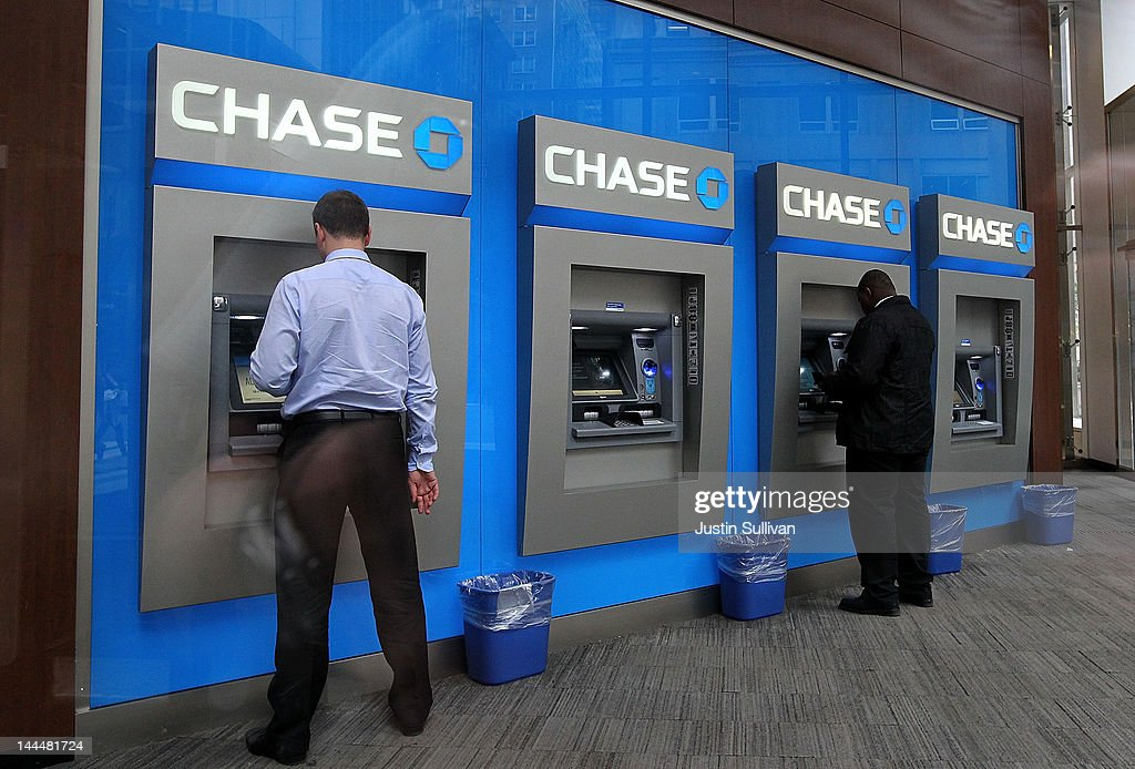 Bank customers use ATMs at a Chase Bank branch on May 14, 2012 in New York City. Following a $2 billion trading blunder, JPMorgan Chase's chief investment officer Ina Drew retired and will be succeeded by Matt Zames, an executive from JPMorgan's investment bank. At least two others are also being held accountable for the mistake.