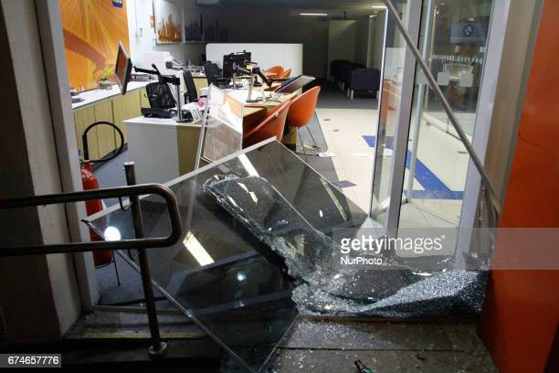 A bank damaged by protestors during a nationwide general strike on April 28 2017 in Sao Paulo Brazil The general strike was conducted in cities...