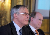Bank de France Governor Christian Noyer and Federal Reserve Bank of Philadelhia President and CEO Charles Plosser listen during a session about...