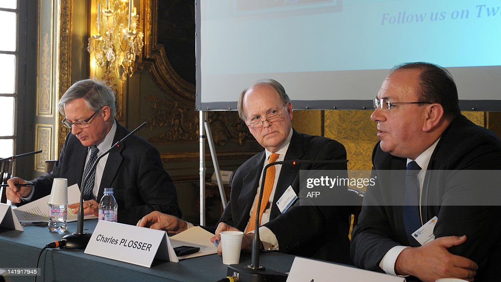 Bank de France Governor Christian Noyer, Federal Reserve Bank of Philadelhia President and CEO Charles Plosser listen to former Deutsche Bundesbank president Axel Weber during a session about 'monetary policy issues' as part of a conference organized by Banque de France and The Gobal Interdependence Center at the Banque de France headquarters in Paris on March 26, 2012. AFP PHOTO ERIC PIERMONT
