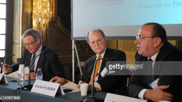 Bank de France Governor Christian Noyer Federal Reserve Bank of Philadelhia President and CEO Charles Plosser listen to former Deutsche Bundesbank...
