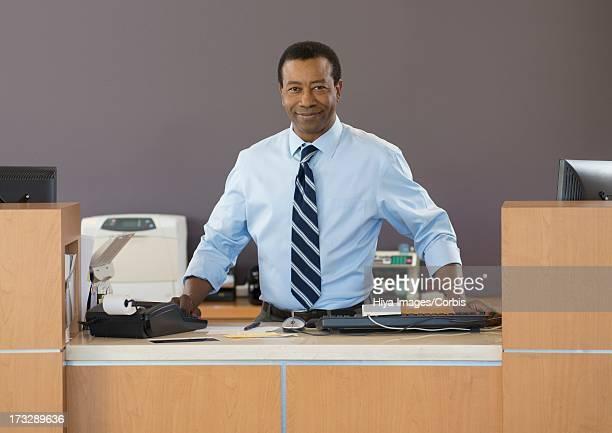 Bank employee at counter