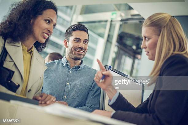 Bank employee explaining loan details to a couple