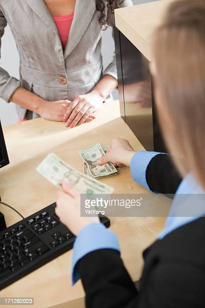 Bank employee transacting with a female customer