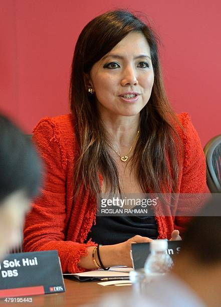 DBS Bank group head of consumer banking and wealth management Tan Su Shan attends a media briefing in Singapore on March 17 2014 Singapore's DBS Bank...