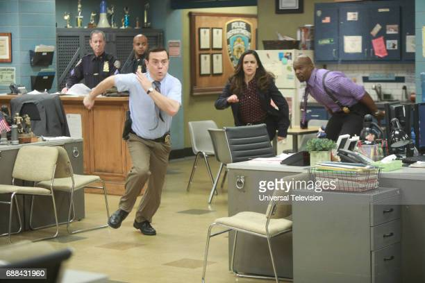 NINE 'Bank Job' Episode 421 Pictured Joe Lo Truglio as Charles Boyle Melissa Fumero as Amy Santiago Terry Crews as Terry Jeffords