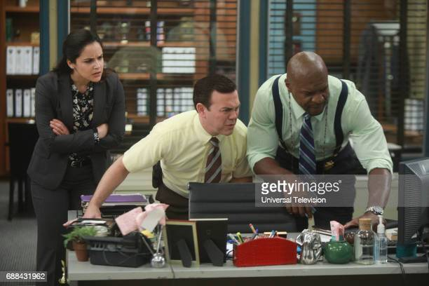 NINE 'Bank Job' Episode 421 Pictured Melissa Fumero as Amy Santiago Joe Lo Truglio as Charles Boyle Terry Crews as Terry Jeffords
