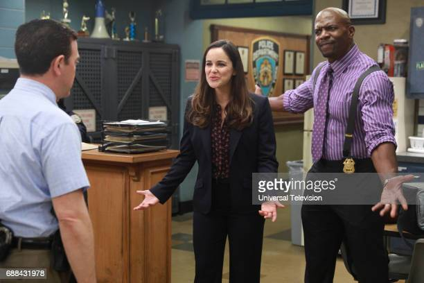 NINE 'Bank Job' Episode 421 Pictured Melissa Fumero as Amy Santiago Terry Crews as Terry Jeffords