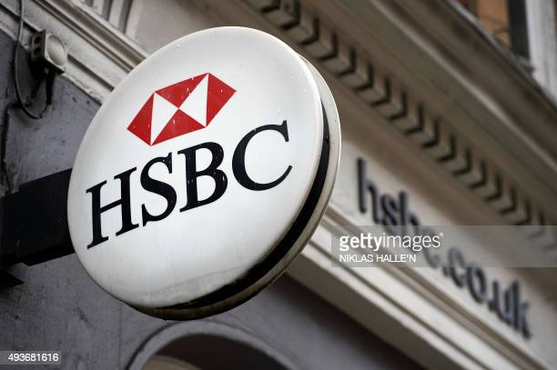 A HSBC bank logo is seen on a sign outside a branch of the bank in London on October 22 2015 Britain's Competition and Markets Authority released its...