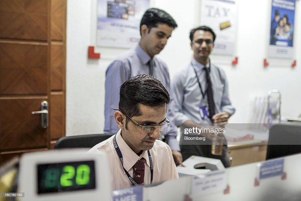 Bank Ltd. employees work at one of the company's bank branches in Mumbai, India, on Friday, Feb. 1, 2013. HDFC Bank, India's second-largest lender by market value, is seeking to expand in the rural market of the world's second-most populated nation to bolster profits as competition in its cities intensifies. Photographer: Dhiraj Singh/Bloomberg via Getty Images
