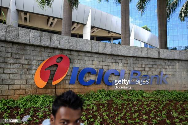 Bank Ltd signage displayed on a wall at the company's headquarters in the Bandra Kurla Complex in Mumbai India on Monday Sept 2 2013 Raghuram Rajan...