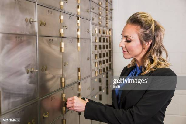 Bank manager locking safety deposit box