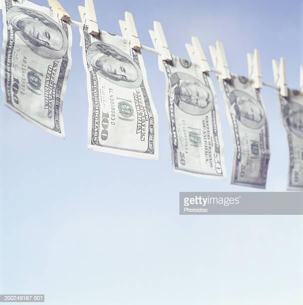 Bank notes hanging on washing line