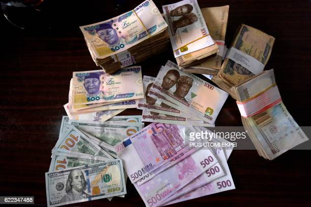Bank notes in naira dollars euros and pounds sterling are pictured in Lagos on January 26 2016 / AFP / PIUS UTOMI EKPEI