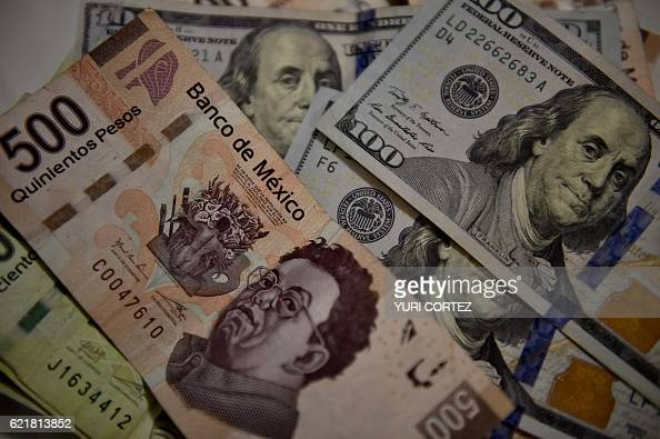 Bank notes of Mexican pesos and US Dollars are pictured in Mexico City on November 8 2016 The dollar tumbled against the yen and euro while the...